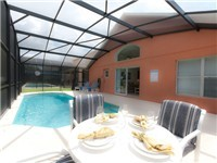 Pool and deck with poolside table for dinning or having drinks.