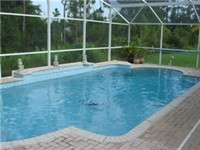 Very large and lovely pool with a nice covered deck/lanai.