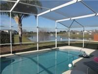 Lovely large pool backs to lake