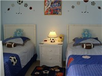 Themed twin room with adult twin beds