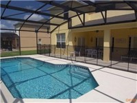 Large sparkling pool with covered lanai for enjoying meals poolside.