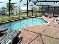 Pool and spa with spacious deck and lots of lounge