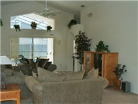 Large and lovely living room that overlooks pool and deck