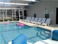 Large sparking pool with deck furniture