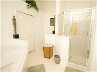Shower and Garden Tub with private toilet.