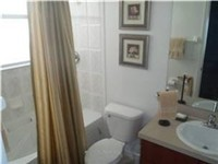 Bathroom adjoins two twin bedrooms