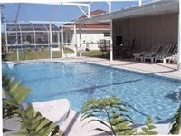 Large sparkling pool and lanai for relaxing poolside meals.