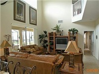 Nice spacious living room with cathedral ceilings.