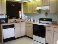 Fully equipped kitchen with open area to dinning room
