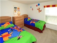 Themed twin bedroom, with full size adult beds