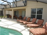 Plenty of loungers for enjoying the pool area.