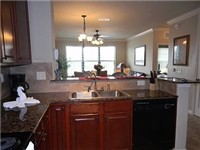 Kitchen overlooks living area and dinning room