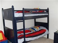 Bunks and a twin bed in bedroom