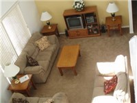 Spacious living area with cathedral ceilings.