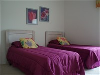 Twin Bedroom with full size adult twin beds.
