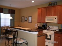Spacious kitchen with bar and dinette.