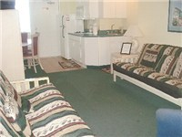 Living room with two futons that open to a full size bed each, plus a full bath off of this area.