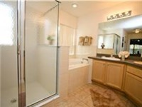 Lovely bathroom with garden tub and walk in shower, plus double vanity