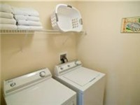 Laundry room fully equipped with iron and board.