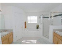 Master Bath / One of 3.5 bathrooms / This one has a garden tub and walk in shower.