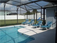 Plenty of seating and loungers in pool area