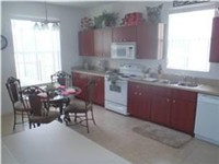 Fully equipped kitchen with lots of space, open and overlooks pool and deck