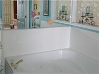 Jacuzzi Garden Tub off of Bedroom. There's also a second bathroom off of the living room with a tub, shower and toilet.