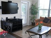 Living area with a large flat screen TV