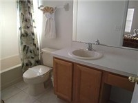 Bath just outside of twin bedroom