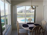Kitchen dinette overlooks pool