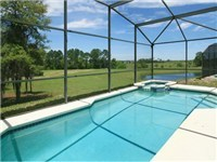 Lovely sparkling pool overlooks golf course & lake
