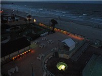 Night view of pool, spa and beach from your balcony.