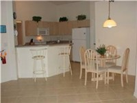 Kitchen with dinette area and counter seats