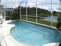 Large and sparking pool that backs to lake for nice privacy