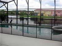 Pool overlooks lake  (This photo shows child fence around the pool).
