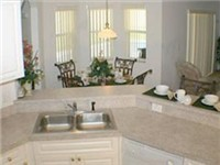 Kitchen overlooks family room and dinette area