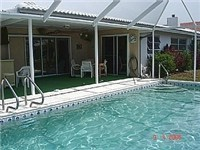 Large lovely pool with covered lanai
