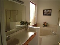 Master bath with garden tub and walk in shower.