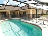Lovely sparkling pool with covered deck area