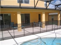 Large covered lanai for enjoying meals around the pool or a nice cool drink or evening margarita pool side.
