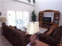 Living room with cathedral ceilings. Overlooks the pool and deck area.