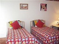 One of three twin bedrooms