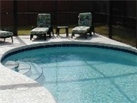Sparkling pool with plenty of patio furniture