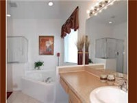 One of 4.5 Bathrooms / with shower and garden tub.