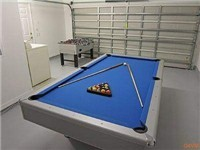 Game Room with Bil lards and Foosball, plus an electronic dart board.