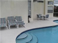 Pool and Deck with loungers and plenty of patio furniture