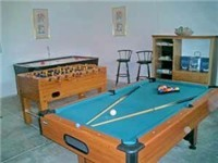 Games room with pool, airhockey and foosball.