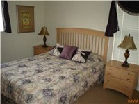 Queen Bedroom  /  Plus four more twin rooms (8 twin beds total)