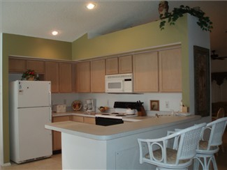 Large spacious fully equipped kitchen. Counter bar.