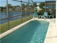 Lovely sparkling pool that backs onto lake for nice relaxing views.